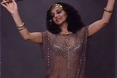 Aida Yossarian in an Assyuti toub performing an asaya dance.