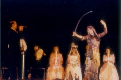 Aisha Ali performing a sword dance to Mohammed Noor playing mizmar.