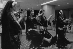 Folk dance from Upper Egypt performed by the Aisha Ali Dance Company in the atrium at the L.A. Clothing Market. circa 1980s.