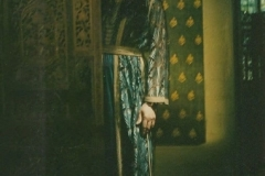 Aisha at home, wearing a Moroccan caftan.
