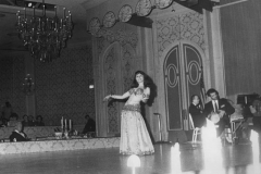 Aisha Ali performing with Tommy Bozekian at the grand ballroom of the Beverly Hilton. 1968 photo by Jules Davis.