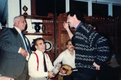 Saadoun Al Bayati and A. J. Racy singing and playing at one of Aisha's parties while Dr. Sabre al Farrah and Mokhtar Khattab