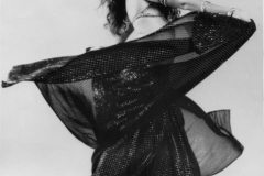 Laura Best performing raqs sharqi for a studio photo. 1970s